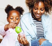 Adorable sweet young afro-american mother with cute little daugh Royalty Free Stock Images