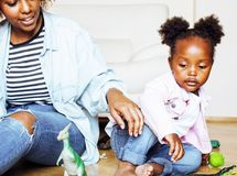 adorable sweet young afro-american mother with cute little daugh stock photo