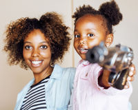 Adorable sweet young afro-american mother with cute little daugh Stock Photography