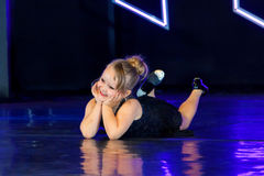 Adorable Tap Dancer Laying On Belly On Stage Stock Photos