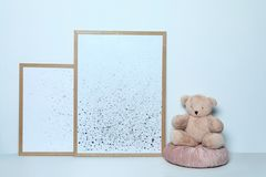 Adorable teddy bear and pictures. Child room interior decor. Adorable teddy bear and pictures on white background. Child room interior decor stock photo