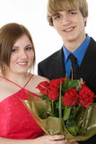 Adorable Teen Couple. In formals with roses. Prom, dance, Valentine's Day or Christmas stock photos