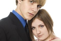 Adorable Teen Couple. In formals with roses. Prom, dance, Valentine's Day or Christmas stock photo