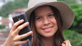Adorable Teen Girl Making Selfies Stock Photography