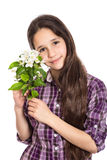Adorable teen girl with pear flowers Royalty Free Stock Images