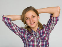 Adorable teen girl. A portrait of an adorable teen girl on the gray background Royalty Free Stock Photo