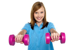 Adorable teen holding dumbbells Stock Photography