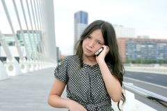 Adorable teenager little girl talking phone royalty free stock image