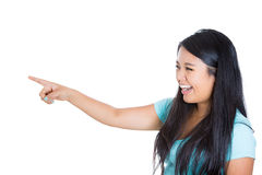 An adorable teenager pointing and laughing at someone or something Stock Photography