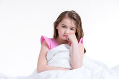 Adorable thoughtful little girl. Royalty Free Stock Images
