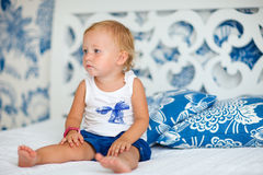 Adorable thoughtful toddler girl in bedroom Royalty Free Stock Photography