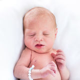 Adorable tiny newborn baby on whire blanket Royalty Free Stock Photography