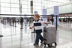 Adorable toddler at the airport Stock Photos
