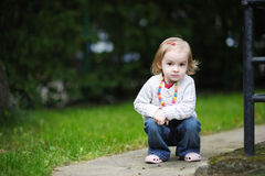 Adorable toddler in an autumn park Stock Photo