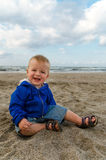 Adorable toddler baby boy  playing in sand Stock Photo