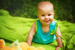 Adorable Toddler Baby Girl playing Stock Images