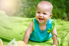 Adorable Toddler Baby Girl playing Stock Photography