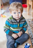 Adorable toddler with blue eyes indoor Stock Photography
