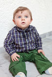 Adorable toddler with blue eyes indoor Stock Image