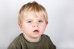 Adorable toddler with blue eyes indoor Royalty Free Stock Photo