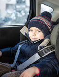 Adorable toddler boy in safety car seat Stock Images