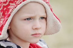 Adorable toddler boy close up in a winter hat Royalty Free Stock Images