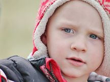 Adorable toddler boy close up in a winter hat Royalty Free Stock Photography