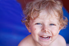 Adorable toddler boy with dirty chocolate face Stock Photo