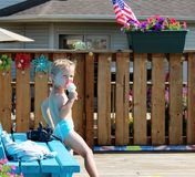 Adorable Toddler Boy eating a Popsicle by the Pool Stock Photos