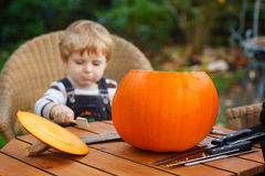 Adorable toddler boy with halloween pumpkin Royalty Free Stock Image