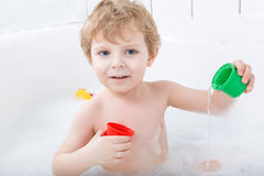 Adorable toddler boy having fun in bathtub Royalty Free Stock Photos