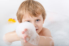 Adorable toddler boy having fun in bathtub Stock Image