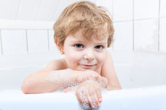 Adorable toddler boy having fun in bathtub Royalty Free Stock Images