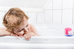 Adorable toddler boy having fun in bathtub Stock Photography