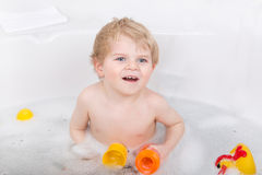 Adorable toddler boy having fun in bathtub Royalty Free Stock Image
