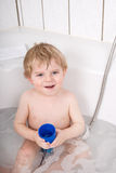 Adorable toddler boy having fun in bathtub Royalty Free Stock Photo