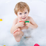Adorable toddler boy having fun in bathtub Stock Photos