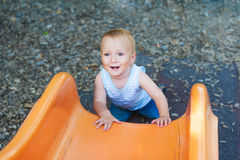 Adorable toddler boy having fun outdoors Royalty Free Stock Images