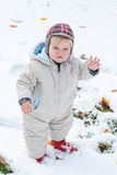Adorable toddler boy having fun with snow on winter day Stock Photography