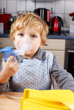 Adorable toddler  boy making inhalation Stock Image