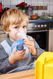 Adorable toddler  boy making inhalation Stock Images