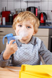 Adorable toddler  boy making inhalation with nebulizer Royalty Free Stock Image