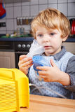 Adorable toddler  boy making inhalation with nebulizer Royalty Free Stock Photography