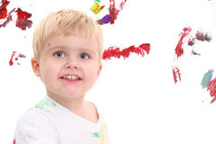 Adorable Toddler Boy Painting At Easel royalty free stock photos