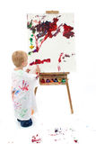 Adorable Toddler Boy Painting At Easel Stock Image