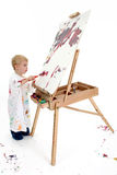 Adorable Toddler Boy Painting At Easel stock photography