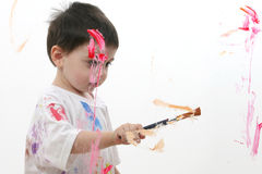 Adorable Toddler Boy Painting On Glass royalty free stock photos