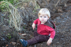 Cute toddler playing  in forest Royalty Free Stock Photos