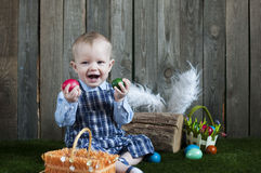 Adorable toddler boy rejoices with Easter eggs Stock Photo