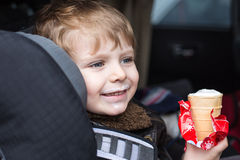 Adorable toddler boy in safety car seat Stock Photo